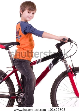 Little beautiful boy with bycicle on white background