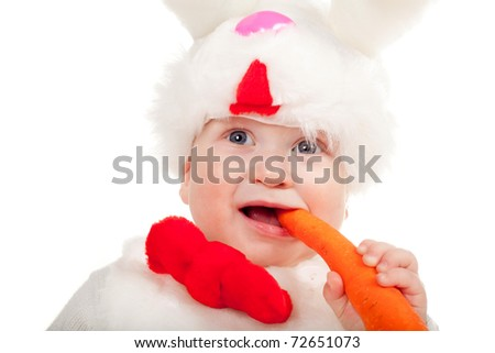 little beautiful boy with carrot in rabbit costume - stock photo