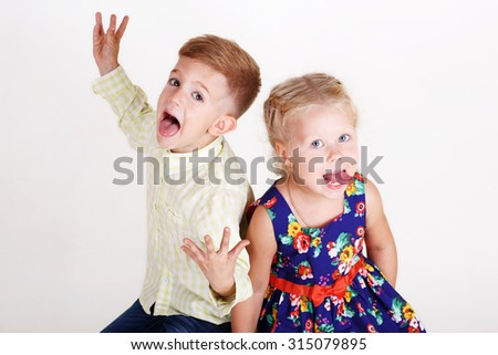 little beautiful friends boy and girl on white background - stock photo