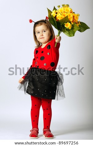 little beautiful funny girl in ladybug costume - stock photo