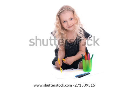 Little beautiful girl draws felt-tip pens. Education drawing. Child draws and looking at the camera. Children at school - stock photo
