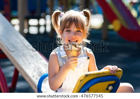 Little beautiful girl eating ice cream
