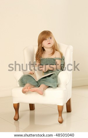 Little beautiful girl in green dress. 2 .y.o - stock photo