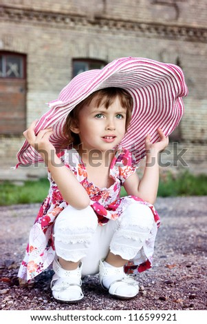little beautiful girl in pink hat - stock photo