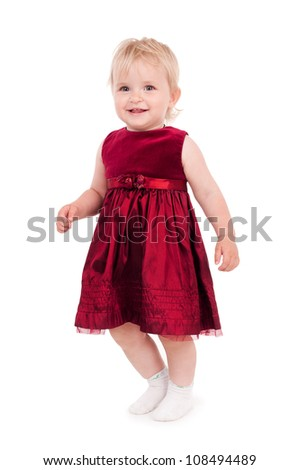 Little beautiful girl in the fashion dress