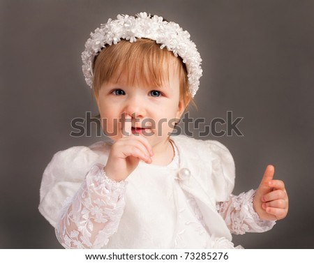 little beautiful girl in wedding dress - stock photo