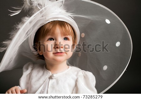 little beautiful girl in wedding dress with gorgeous hat - stock photo