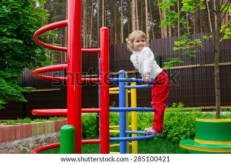 little beautiful  girl on a playground - stock photo