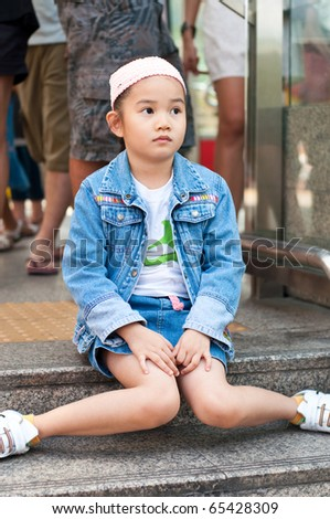 Little beautiful girl, she is waiting, Thailand. - stock photo
