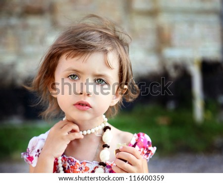 little beautiful girl  with chocolate in park