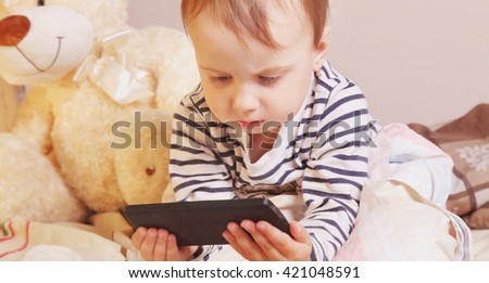 Little beautiful  girl with smart phone