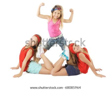 Little beautiful gymnasts - stock photo