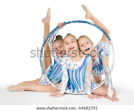 Little beautiful gymnasts with the hoop - stock photo