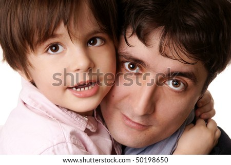 Little beautiful smiling boy hugs his young attractive father on white background - stock photo