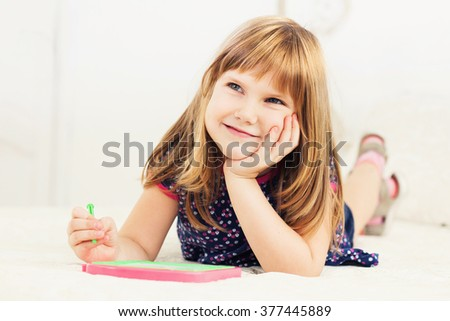 Little beautiful smiling girl iplaying in the room - stock photo