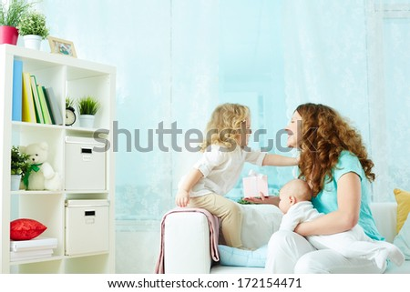 Little beauty wishing her mom a happy birthday - stock photo