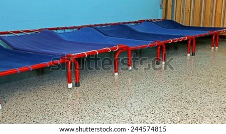 little beds of a dormitory of kindergarten children - stock photo