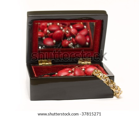 little black box filed with jewellery isolated on white