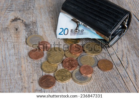 little black coin purse with some coins - stock photo