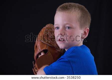 Little blond baseball player ready to pitch the ball.