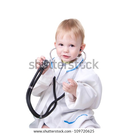 Little blond boy dressed as a doctor and with stethoscope in his hands isolated on white background. Ready to receive patients. - stock photo
