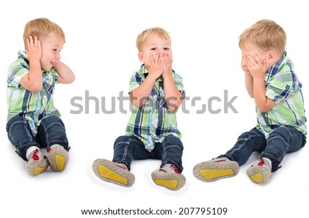 little blond boy stop to listen, stop to speak and stop to see - stock photo