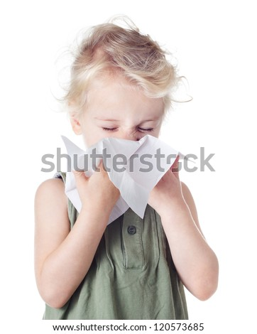 Little blond girl blowing her nose - stock photo