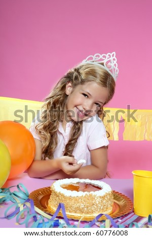little blond girl in birthday party eating cake - stock photo