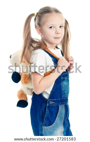 Little blond girl in blue overalls wearing cow-shaped rucksack