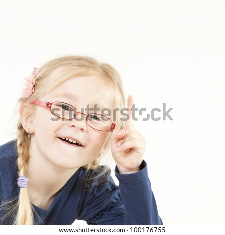 Little blond girl showing with hand - stock photo