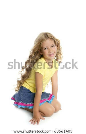 little blond girl smiling portrait on her knees isolated on white background - stock photo
