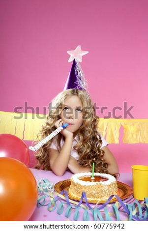 little blond sad girl in birthday party - stock photo