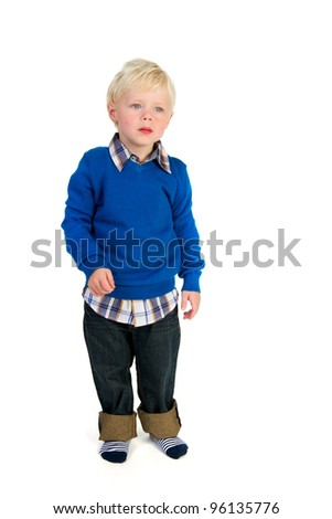 Little blond toddler standing in the studio