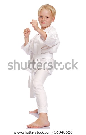 little blonde boy dress karate uniform isolated on white - stock photo