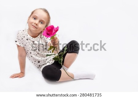 Little blonde girl offering a rose isolated on white background - stock photo