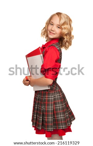 little blonde girl wearing plaid dress holding copy-book and pencils isolated on white  - stock photo