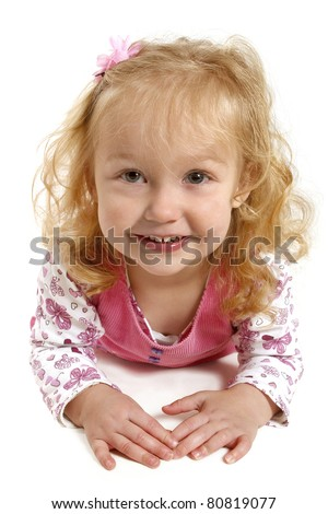 Little blonde girl with a big smile wearing pink