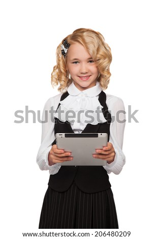 little blonde student wearing uniform holding tablet over white background - stock photo