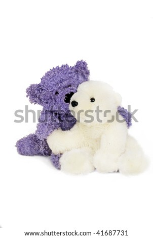 Little blue bear cuddles little white polar bear. - stock photo