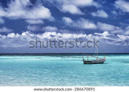 Little boat in the sea, fishing in warm sunny day, beautiful landscape, amazing travel destination, summer vacation on Maldives, Asia - stock photo