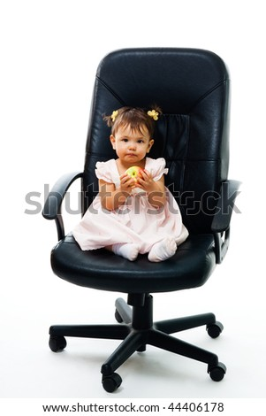 Little boss - child with apple sit in office chair,isolated on white