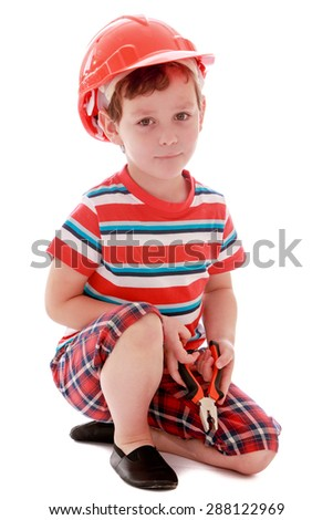 Little boy a helmet on his head-isolated on white background - stock photo