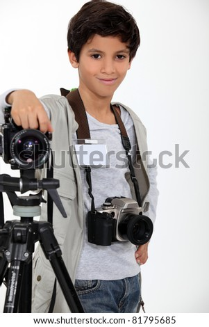little boy acting like a professional photographer - stock photo