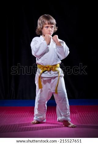 Little boy aikido fighter on black - stock photo