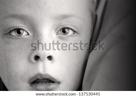 little boy alone with his mouth open black and white - stock photo