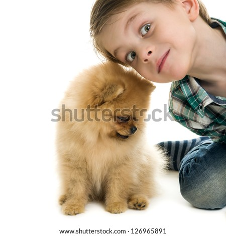 Little boy  and a puppy on a white background