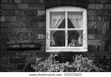 little boy and cat sitting on the window - stock photo