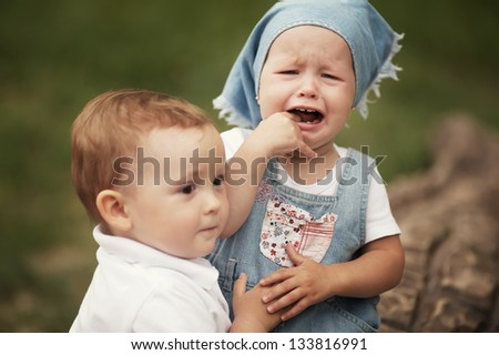 little boy and crying girl - stock photo