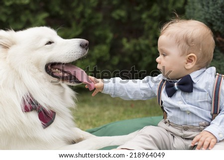 Little Boy and Dog - stock photo