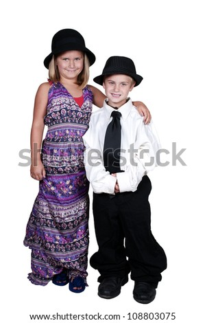Little boy and girl dressed in oversized suit clothes - stock photo